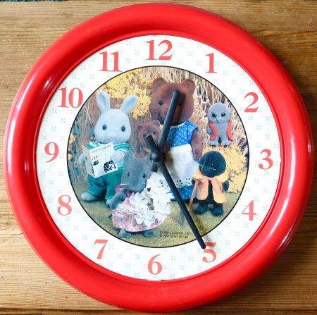 A wall clock for the nursery showing the first range of TOMY Sylvanian Families figures. Made in Great Britain 1987.